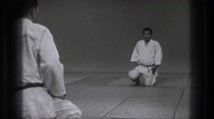 1971: martial artists bow to each other in the gym TOKYO JAPAN Stock Footage