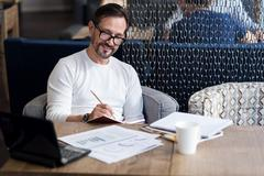 Smiling bearded man checking his agenda Stock Photos