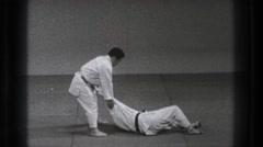 1971: illustrating karate moves at a dojo. TOKYO JAPAN Stock Footage