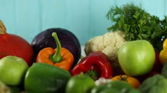 Fresh organic fruits and vegetables on wooden background Stock Footage
