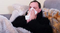 Man is sick and nose snort Stock Photos
