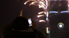 People taking photograph with camera phone of Fireworks Taipei 101 in New Year Stock Footage