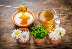 Herbal tea with mint, chamomile, jasmine flowers and honey Stock Photos