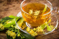 Green herbal tea with linden flowers, closeup Stock Photos