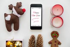 Flat view of phone in the centre of Happy new year decoration Stock Photos