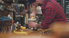 Barista squeezes the juice from fresh oranges Stock Footage