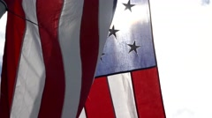 Sun, ray of light behind close up shot of waving flag of United state of America Stock Footage