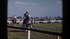 1957: cowboys riding horses at a rodeo WHEELING OHIO Stock Footage