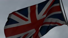 National flag of Great Britain United Kingdom England waving in a windy weather Stock Footage