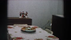 1958: man looks over dining room preparations for christmas dinner ITALY Stock Footage