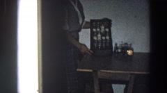 1958: woman holding a rack of bottles kept on the table and detailing ITALY Stock Footage