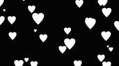 Falling white cartoon hearts over black background Stock Footage