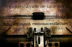 Employment form on vintage typewriter Stock Photos