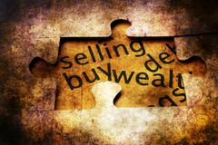 Selling buy puzzle grunge  concept Stock Photos