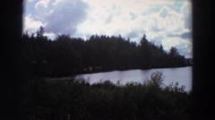 1964: thunder clouds forming over a pristine mountain lake. CALIFORNIA Stock Footage