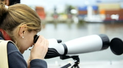Woman looking at view with monocular Stock Footage