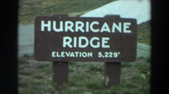 "1964: marker indicating ""hurricane ridge: elevation 5,229'"" and parking lot. Stock Footage"