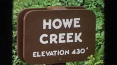 1964: sign board about howe creek elevation 430 WASHINGTON Stock Footage