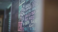 Chalk board. Black board. On the black slate written coffees Stock Footage