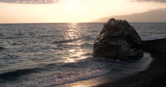 View of Waves Rolled at Sea Coast Line With Huge Rock at Sunset Stock Footage