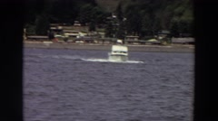 1964: a boat crossing calm water just off the shore. WASHINGTON Stock Footage