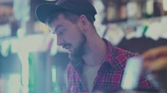 A young man in a plaid shirt hipster barista work Stock Footage