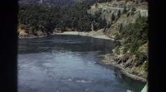 1964: view of a very calm huge lake and land with trees among it WASHINGTON Stock Footage