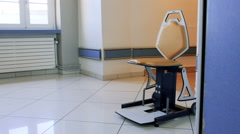 Empty medical chair in hospital coridor Stock Footage