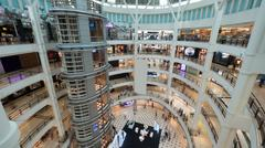 Multistorey shopping mall with customers Stock Photos