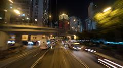 Night Hong Kong cityscape with transport traffic on the road Stock Photos