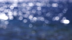 Blue seascape surface with glittering sunlight in bokeh Stock Footage