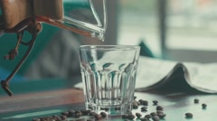 Slowmotion. Siphon coffee. In a clear faceted glass pours coffee Stock Footage