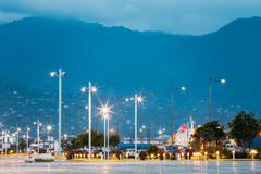 Batumi Georgia Crossing Rows Of Luminous Lampposts At Quay. Mountain View In Stock Photos