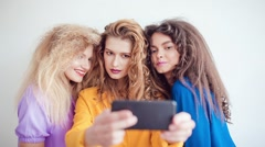 Fashion girls with professional makeup and crazy hair style, make selfie over Stock Footage