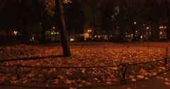 Camera goes down in mystery light near mysterious man who's sitting in the park. Stock Footage