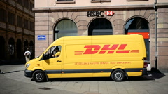 DHL van delivery leaving in front of hsbc bank Arkistovideo