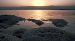 Landscape with the rising sun on Dead Sea Stock Footage