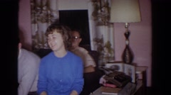 1965: the whole family gathered around laughing and full of cheer FALLSTON Stock Footage