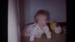 1965: baby is on hands and knees in corner and sitting in bathtub Stock Footage