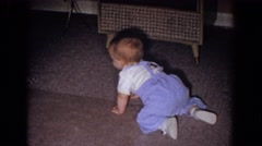 1965: little baby learning to crawl on the front room carpet. FALLSTON MARYLAND Stock Footage