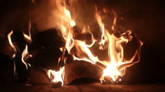Closeup of flame and embers burning in a wood-fired oven Stock Footage