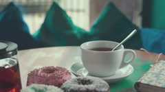 Female hand stirs sugar in a cup of tea. Morning breakfast. Appetite Stock Footage