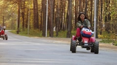 Young beautiful woman driving ATV in slow motion, hand hold steering wheel Stock Footage