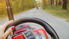 Young woman driving ATV, close up of hands hold steering wheel in slowmotion Stock Footage