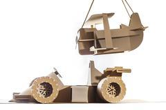 Cardboard racing car and cardboard plane Kuvituskuvat