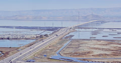 Aerial of freeway traffic on San Mateo Bridge in silicon valley Stock Footage