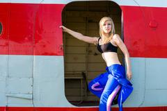 Sexy woman pilot in the door plane Stock Photos