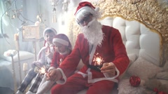 Little children,  kids boy and girl and Santa Claus happy Arkistovideo