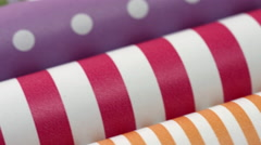 Multicolored wrapping paper rolls Stock Footage