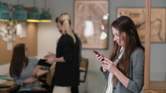 Beautiful brunette woman uses a touchscreen tablet in the modern startup office Stock Footage
